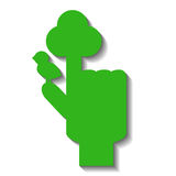Green hand with pointed finger with symbolic tree and bird. Tree symbol by hand. Tree and bird logo. Green hand for environment or ecological problem. Tree Royalty Free Stock Photo