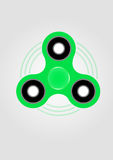 Green hand spinner fidget toy. Drawing. Toy for stress relief and improvement of attention span Stock Photos
