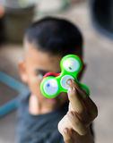 Green hand spinner in hand. Royalty Free Stock Photos