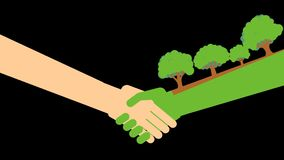 A green hand with trees an a human hand.