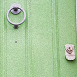 green  handle in london     antique brown door  rusty  brass nail an Stock Images