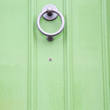 green  handle in london antique brown door  rusty  brass nail an Stock Photos