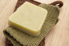 Green Handmade Soap on a Wooden Background Image stock