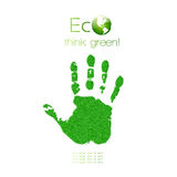 Green handprint made from grass. Think Green. Ecol Royalty Free Stock Photo