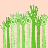 Green hands in the air with apple Stock Image