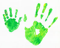 Green hands. Two green hand prints. One is from an adult and one is from a child Stock Image