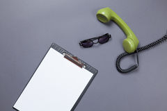 Green handset with sunglasses Royalty Free Stock Photos