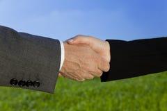Green Handshake Stock Photo
