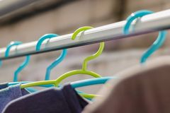Green hanger Plastic In the clothes array with a blue hanger Plastic. royalty free stock photography