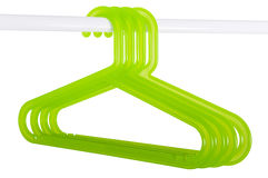 Green hangers on a rod isolated on white Royalty Free Stock Photography