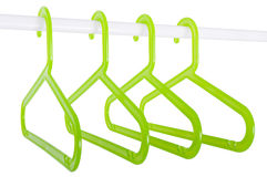 Green hangers on a rod isolated on white Royalty Free Stock Photo