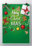 Green hanging poster with Christmas graphics stock images