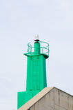 Green harbour beacon Royalty Free Stock Photo