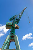Green Harbour Crane. Against blue sky stock photos