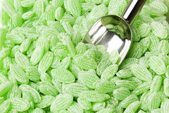 Green hard candy with shovel Royalty Free Stock Images