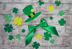 Green hat, bow and clover leaves. Handmade Saint Patricks Day Royalty Free Stock Image