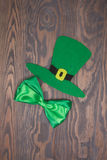Green hat and bow tie on wooden background. Handmade Patricks Day Royalty Free Stock Photo