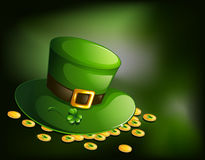 A green hat with gold tokens Royalty Free Stock Images