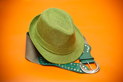 Green hat and green belt with a buckle Royalty Free Stock Photography