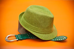 Green hat and green belt with a buckle Stock Image