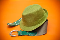 Green hat and a green belt with a buckle in western style Stock Images