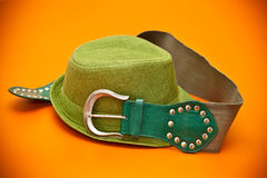 Green hat and a green belt with a buckle in western style Royalty Free Stock Image