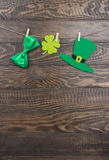Green hat, satin bow and quatrefoil clover on clothespins. St. Patricks Day Royalty Free Stock Photo