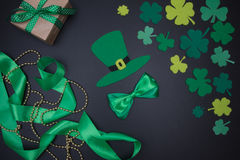 Green hat and satin bow tie on blackboard. St.Patricks Day Royalty Free Stock Images