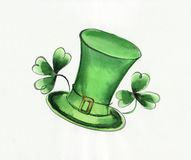 Green hat and shamrock Stock Images