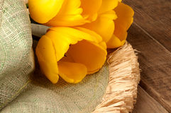 Green Hat with Three Yellow Tulip on Rustic Wood Royalty Free Stock Photography