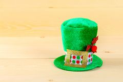 A green hat on a wooden table. St.Patrick 's Day. A green hat on a wooden table. St.Patrick 's Day Royalty Free Stock Images