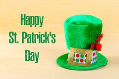A green hat on a wooden table. St.Patrick 's Day. A green hat on a wooden table. St.Patrick 's Day Royalty Free Stock Image