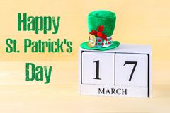 A green hat on a wooden table. St.Patrick 's Day. A wooden calen. Dar showing March 17 Royalty Free Stock Image