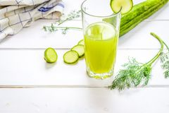 Healthy cucumber drink. Green Healthy drink from fresh cucmber on white table Royalty Free Stock Photography