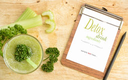 Green healthy drink with white sheet on clipboard Royalty Free Stock Images