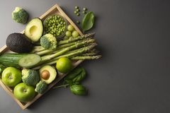 Green healthy food clean eating vegetables: asparagus, cucumber, basil, green peas, avocado, broccoli, lime, apples, grapes,. Green healthy food clean eating royalty free stock image