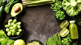 Green healthy food composition with avocado, broccoli, apple, smoothie... stock video