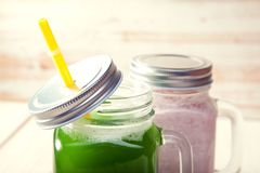 Green healthy smoothie in glass jar on rustik wood.  Stock Images