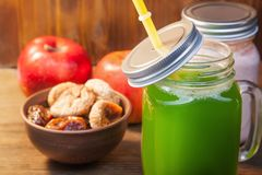 Green healthy smoothie in glass jar on rustik wood.  Stock Photography