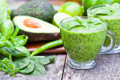 Green healthy vitamin cocktail in the glass cup Royalty Free Stock Image