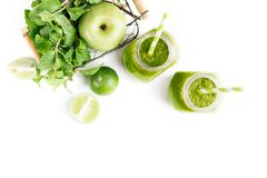 Green healty drink in two mason jars with green apple, mint and lime on white background. Vegetarian food concept. Detox. Text space Stock Photography