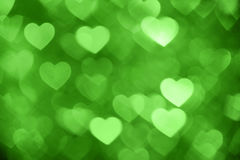 Green heart bokeh background photo, abstract holiday backdrop Stock Photo
