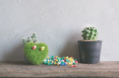 green heart, book cactus flower on wood table, love and valentin Royalty Free Stock Photography