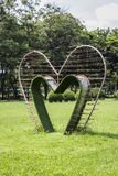 Green heart bower. Green heart shape bower on lawn, Lumphini Park, Bangkok Thailand Stock Photo