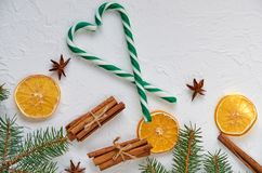 Green heart of candy cones with spices - anise stars, dried oranges, cinnamon sticks on the white background royalty free stock photos