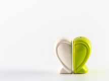 Green heart containers for salt and pepper Royalty Free Stock Images