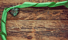 Green heart with green silk ribbon Stock Photos