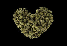 Green heart made of marijuana Royalty Free Stock Photos