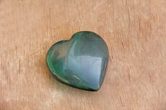 Green heart made of natural stone jade. A heart shaped stone lie