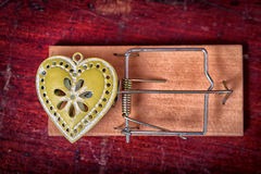 Green heart and mouse trap Royalty Free Stock Image
